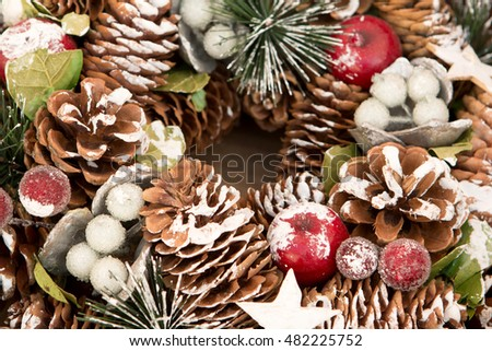 Delicate Christmas wreath of pine cones on gray wooden background