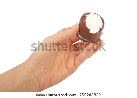 Delicate dessert souffle with chocolate in hand isolated on white - stock photo