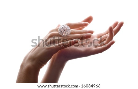 delicate hands with beautiful diamond ring - stock photo
