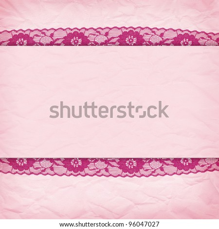 Delicate pink background crumpled paper with a border of lace
