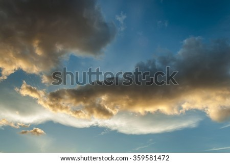 delicate yellow orange clouds in a sunset sky