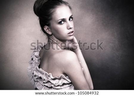 delicate young woman portrait in studio - stock photo
