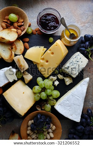 delicatessen cheeses with fruits, top view
