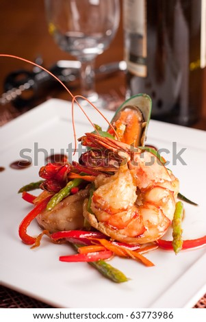 Delicatessen dish with tiger shrimps, mussels and vegetables