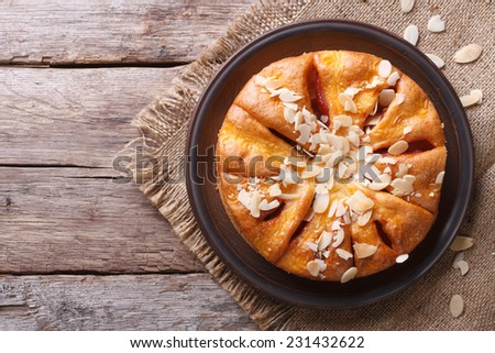 Delicious almond pear pie closeup at the table. top view of the horizontal  - stock photo