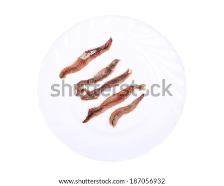 Delicious anchovy. Isolated on a white background. - stock photo