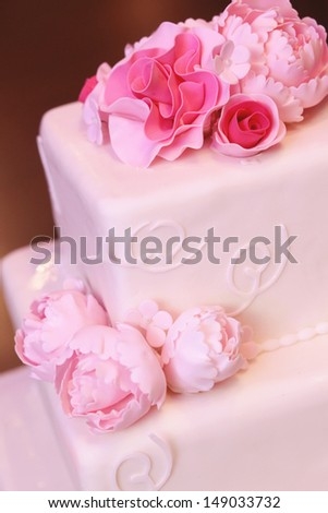 Delicious and beautiful wedding cake with peonies - stock photo