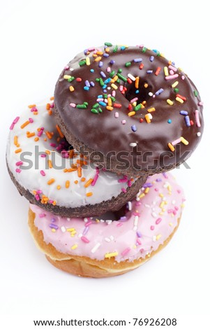 Delicious and colorful donuts on white background - stock photo