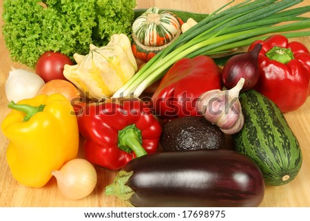 Delicious and colorful fresh vegetables: peppers, eggplant, pattypan squash (scallopini), courgette (zucchini), onions, tomatos, lettuce and avocado