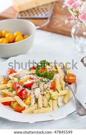 Delicious and fresh pasta with tomatoes, chives and parsley
