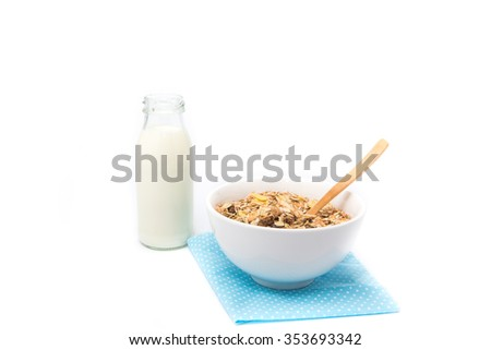 Delicious and healthy cereal in bowl with milk. Morning breakfast isolated on white background - stock photo