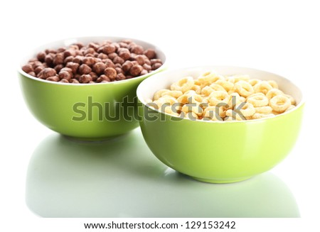 Delicious and healthy cereal in bowls isolated on white - stock photo