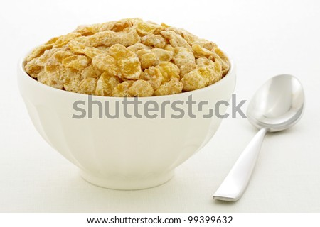 delicious and healthy frosted with sugar corn flakes, served in a beautiful French Cafe au Lait Bowl - stock photo