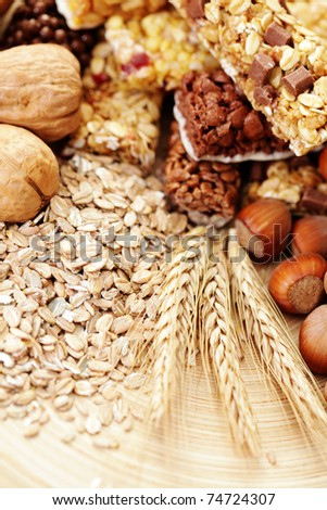 delicious and healthy granola bars with some nuts - diet and breakfast - stock photo