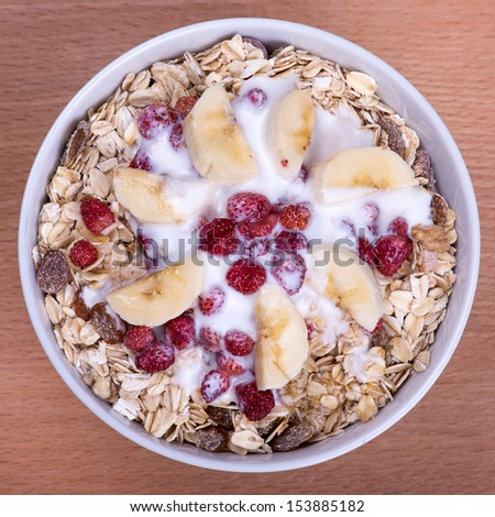 Delicious and healthy granola or muesli, with lots of dry fruits, nuts, berries and grains - stock photo