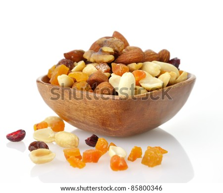 Delicious and healthy mixed dried fruit, nuts and seeds - stock photo