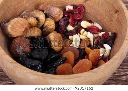 Delicious and healthy mixed dried fruit on bowl - stock photo