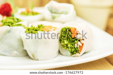 Delicious and healthy Vietnamese rice paper rolls with chicken and vegetables. - stock photo