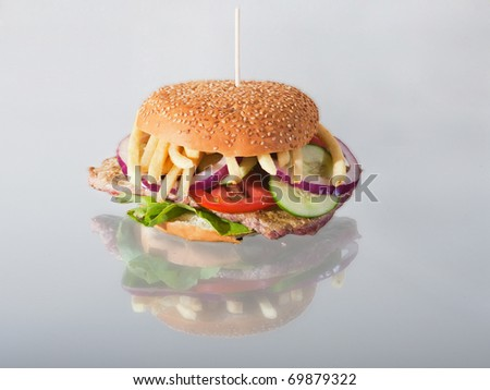 Delicious and juicy  burger with reflection - stock photo