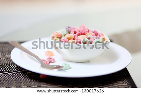 Delicious and nutritious cereal  on white background, healthy and funny addition to kids breakfast - stock photo