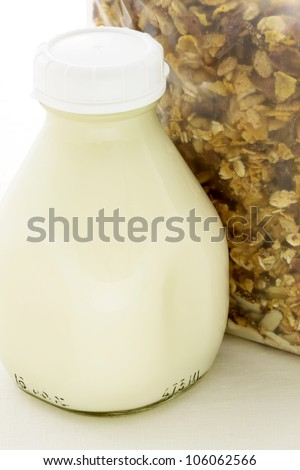 Delicious and nutritious fresh muesli and healthy Pint Glass Milk Bottle. - stock photo