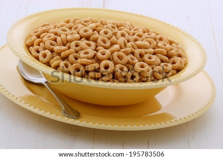 Delicious and nutritious lightly toasted breakfast honey nuts cereal loops on vintage styling - stock photo
