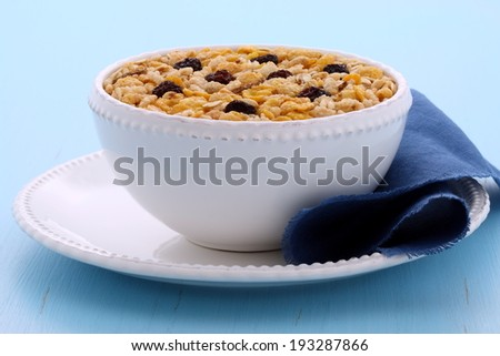 Delicious and nutritious lightly toasted breakfast muesli or granola cereal on vintage styling. - stock photo