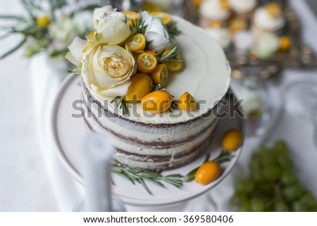 Delicious and tasty dessert table at wedding reception cream pie, macaroons and cupcakes - stock photo