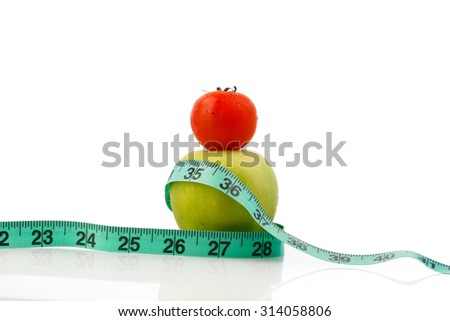 Delicious and tasty green apple with green measuring tape and tomato cheery isolated in white background - diet, fitness, lifestyle, healthy and vegetarian concept - stock photo