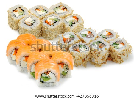 Delicious appetizer in the foreground. Japanese traditional food. Standard sushi set with its great component - soft cheese philadelphia. Rolls with caviar, sesam, cucumber, avocado and salmon. - stock photo