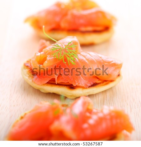 delicious appetizer with salmon pancakes - stock photo