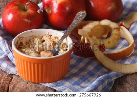 Delicious apple crumble close-up in a pot. Horizontal rustic style