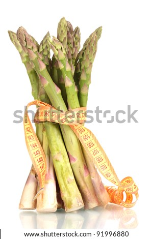delicious asparagus and measuring tape isolated on white