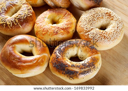 delicious assorted bagel on wooden table - stock photo