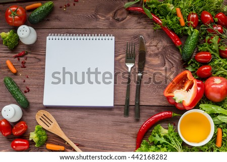 Delicious Assorted fresh vegetable, tomato, cucumber, pepper, carrot - healthy food, diet or cooking concept. Dish with vegetables inside. - stock photo