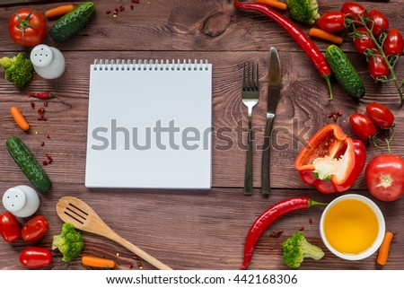 Delicious Assorted fresh vegetable, tomato, cucumber, pepper, carrot - healthy food, diet or cooking concept. Notebook for text. - stock photo