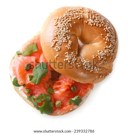 delicious bagel with red fish and soft cheese isolated on a white background close-up. top view  - stock photo