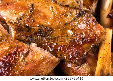 Delicious baked lamb meat. Macro. Photo can be used as a whole background.