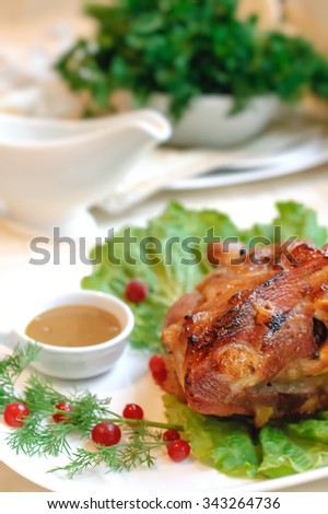 Delicious baked meat with spicy and mustard sauce. Selective focus - stock photo