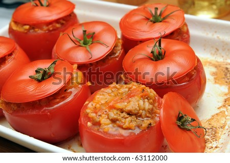 Delicious baked stuffed tomatoes with meat and vegetables - stock photo