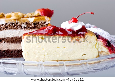 Delicious beautiful gourmet cherry cheese cake on a plate - stock photo