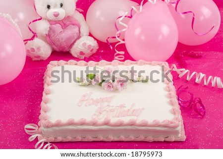 Delicious beautifully decorated birthday cake, teddy bear and balloons - stock photo