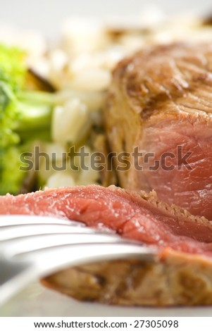 delicious beef grilled whith rice and vegetables - stock photo