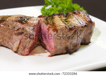 Delicious beef steak in a white dish - stock photo