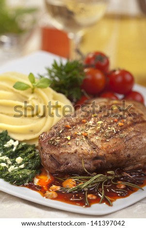Delicious beef steak with spaniard and potatoes - stock photo