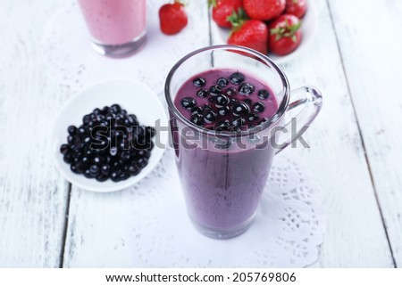 Delicious berry smoothie on table, close-up - stock photo
