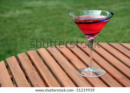 Delicious beverage placed outside atop a picnic table.