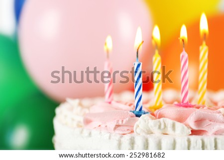 Delicious birthday cake on bright background - stock photo