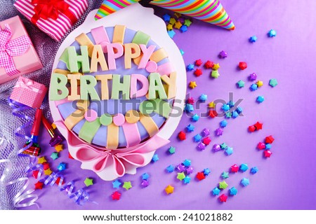 Delicious birthday cake on table close-up - stock photo