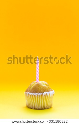 Delicious birthday cupcake on table